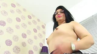 Sexy raven-haired mom is getting naked